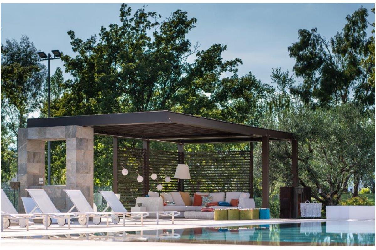 kedry prime crea una zona de relajacin al lado de la piscina en una casa en atina